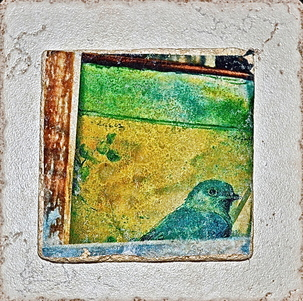 Photograph of bluebird in window transferred to tile